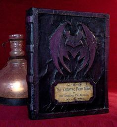 DIY Creepy Books using paper towels for texture and cardboard for nameplate and image.