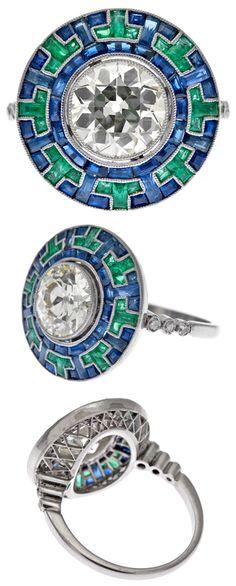 Diamond, Sapphire, Emerald, and Platinum Engagement Ring.