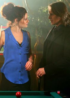 "Emile de Ravin as Belle and Robert Carlyle as Mr. Gold from the TV Show ""Once Upon A Time""."
