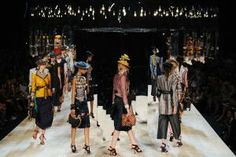 Marc Jacobs showcased his collection on a sloping runway filled with free-standing mirrors and lit with bare bulbs.