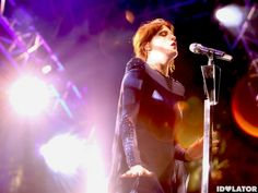 Florence performing in her custom Hannah Marshall cape accented with SWAROVSKI crystals