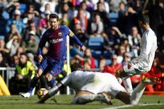 """Barcelona's Argentinian forward Lionel Messi runs wit the ball during the Spanish League """"Clasico"""" football match Real Madrid CF vs FC Barcelona at the Santiago Bernabeu stadium in Madrid on December 23, 2017. / AFP PHOTO / OSCAR DEL POZO"""