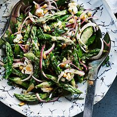 Asparagus Summer Salad | Sunset magazine | The combination of fat, juicy stalks of barely cooked asparagus with generous fresh herbs and salty feta cheese makes this one of our favorite ways to use a peak-season ingredient.