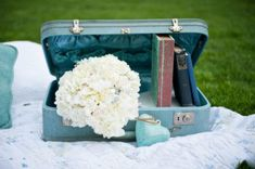 Vintage suitcases with Calvary stickers and retreat stickers on it- as centerpiece for each blanket area.