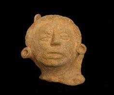 Mayan Terracotta Sculpture of a Head -  Origin: Mexico Circa: 500 AD to 900 AD Dimensions: 5.75 (14.6cm) high Collection: Pre-Columbian Medium: Terracotta
