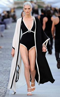 What a great bathing suit and cover-up! I'd expect nothing less from Chanel, of course    -repinned: Chanel 2011/2012 Cruise Collection.  Yes, this is the ultimate!