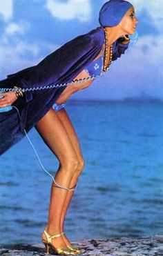 1975 vogue...In high heels, on the phone ( Not a mobile!!!) at the beach...I love the 70s!