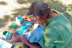 Homeless artist making an honest living. He's making a door sign for my mom. KAHAWAII