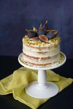 Pistachio cake with orange cream frosting & fresh figs