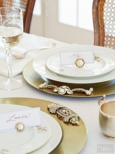 Give place settings something to twinkle about -- embellish chargers with vintage costume jewelry. Secure a piece or two of jewelry to the top of each charger with hot glue or metal glue. Jewelry items that lie flat work best, so look for pieces with metal backs that can be bent or easily removed with pliers or wire cutters. To complete the setting, use clip-on earrings to prop up place cards./