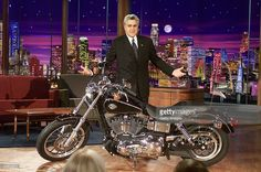 In this NBC Entertainment handout, 'Tonight Show with Jay Leno' host Jay Leno stands next to a Harley-Davidson motorcycle January 3, 2005 in Burbank California. Leno annouced on the show the he would partner with Harley-Davidson to raise funds for victims of the Indian Ocean tsunami. Leno will have guests sign the motorcycle and then auction it off.