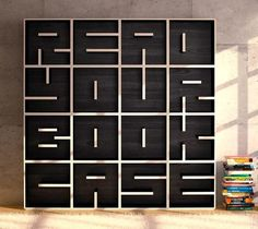 awesome bookcase. Storage modulars shaped into letters. Looks like it could be pretty easy to DIY.