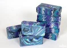 """This celestial inspired cold process project was created with a technique known as the """"Clyde Slide."""" This technique was created by ClydeYoshida of Vibrant Soaps; be sure to check out his awesome YouTube channel here.This fun swirl involves layering multiple colors in one pot, then pouring the soap into the mold. As the soap """"slides"""" …"""