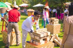 Looking for Giant jenga game for guests at mehendi? Browse of latest bridal photos, lehenga & jewelry designs, decor ideas, etc. on WedMeGood Gallery. Desi Wedding Decor, Wedding Hall Decorations, Wedding Ideas, Wedding Planning, Mehndi Decor, Mehendi, When Everything Falls Apart, Wedding Games For Guests, Jenga Game