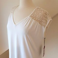 🎉HP🎉 NWT Vince Camuto Top NWT Vince Camuto Top...v-neck, short sleeve blouse from the Divine Retreat collection...crochet shoulder and back detail...body: 96% rayon 4% spandex...shoulder: 100% cotton...machine wash cold. Retail $69 Vince Camuto Tops Blouses