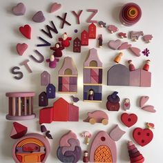 GRIMMS | these amazing wooden toys, blocks, letters and houses in different colours of pink, red and purple are from Grimm's Toys. A German brand with wooden toys. Made by hand, oiled with natural oil and painted with water based paint.