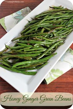 These Honey Ginger Green Beans are the perfect side - sweet and spicy with a bit of warmth from fresh ginger - what's not to love?  http://cookinginstilettos.com/honey-ginger-green-beans/  #SideDish #Beans #Ginger #Holiday