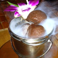 Smoking balls of yumminess: vanilla bean ice cream balls dipped in chocolate and placed over dry ice in a mini bucket