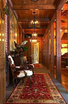 Cabin Decor - Foyer...love the cowhide chairs, runners, lighting ~ Cindy Meador Interiors