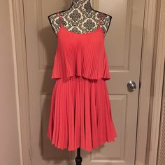 Coral Gianni Bini Pleated Dress This is a gorgeous coral strappy dress with two layers of fabric that overlap one another. Size Small, fast shipping! Perfect pre-owned condition! Gianni Bini Dresses Midi