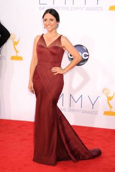 Emmy Awards 2012: Julia Louis-Dreyfus opted for a sleek Bordeaux-hued gown by Vera Wang.  #Emmys