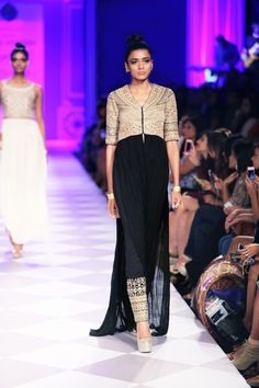 Presenting a black kurta jacket with embroidered pants. The meticulous gold body creates the drama.$32,400.00