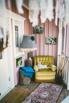 Porch with vintage yellow chair and pinkt shade