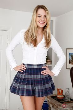 Plaid girls pleated skirts wearing