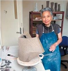 Kayoko Hoshino, (Photo Greg Daly). Her medium is a blend of several types of clay, mostly the pebbly material from Shigaraki. Cut from wedges, her forms are deceptively simple, with the feel of ancient ceramics, but also possess a distinctly modern sense of balance. Her clay takes on a wood-like texture, and the platinum and silver glazes add a reflective quality. Bowls seem pulled from the ground with her use of subdued earth tones, and Kayoko twists her sculptures to give them powerful…