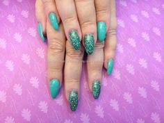 Acrylic nails with green gel polish and green glitter gel polish