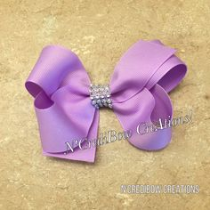 Almost any color available! Etsy shop https://www.etsy.com/listing/598158073/purple-boutique-bow-big-boutique-hair