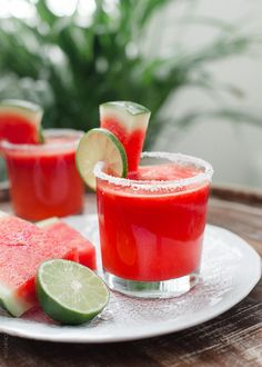 Watermelon Lime Margaritas 1/4 cup kosher salt  2 limes  2 cups diced watermelon  3 tablespoons agave nectar (to taste)  4 ounces tequila  1 ounce Cointreau  1 cup ice cubes  watermelon slices, for serving  lime slices, for serving