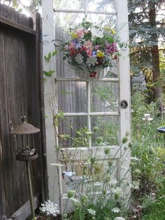 I have a door just like this sitting in my shed...Whimsical Raindrop Cottage, gardeningacreativejourney: (via TumbleOn)