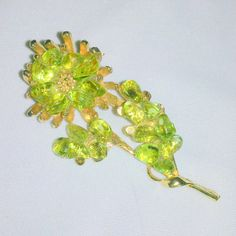 Vintage Crushed Peridot Flower Brooch by BorrowedTimes on Etsy