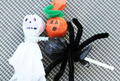 Lollipops + Pipe Cleaners + Garbage Bags [black & white] + orange tissue paper, SO EASY and cute! via Apartment Therapy #Halloween #Bewitched
