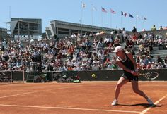 Tennis: Russia's Vera Dushevina hits a return to Serbia's Jelena Jankovic during their Women's second round match in the French Open tennis championship at the Roland Garros stadium, on May 25, 2011, in Paris