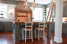 Renovating an older home always comes with a set of challenges — particularly when you're working with a home from the 18th century! This 1790 New Jersey kitchen still had its original brick fireplace, which the owners were intent on retaining. The fireplace was outfitted with a functional stove and new foggy-blue cabinetry completes the timeless look.