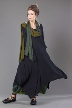 I love these colours together: the dress reads as a deep charcoal to me but it might be black. The green scarf is a bit olive/warm toned but the overall idea of mixed blue/grey/greens and soft long layers appeals to me