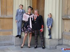 Veteran singer Sir Rod Stewart at Buckingham Palace in London, with his wife, Penny Lancaster and children Alastair and Aiden, after he received his knighthood in recognition of his services to music and charity. Gareth Fuller/PA wire