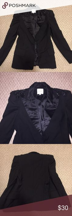 Because Black Blazer With Shoulder Embellishment Worn once. A tiny part of the embellishment on the left shoulder is loose but it just needs to be sewn. Can fit 0-2 because Jackets & Coats Blazers