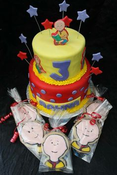 Caillou cake with cookie favors
