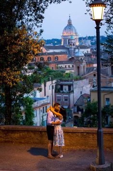 #Engagement photo session under street lamp post at dusk in #Rome Italy. Photo by www.andreamatone.com