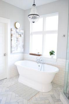 Light And Bright Master Bathroom With Benjamin Moore Sleigh Bells Walls Marble Herringbone Floor Tile