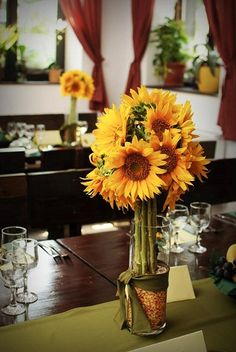 Sunflower centerpiece...gathered at the heads to create a more tailored centerpiece.