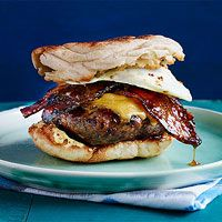 Brunch Burgers- Rachel Ray's burgers topped with cheese, maple brown sugar peppered bacon and eggs on English muffins. Yummo!