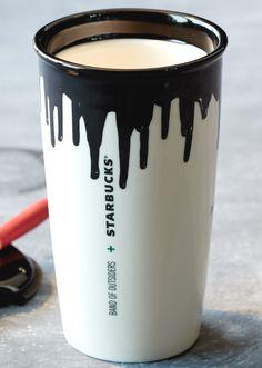 a ceramic coffee mug with turtle hare themed artwork