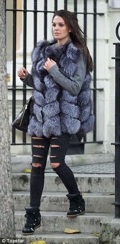 Comfy and cosy: The 31-year-old wore a pair of ripped jeans and a furry gilet