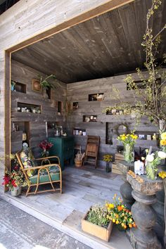 A corner like this... read, enjoy the fresh air, have some pretty plants, and then make it indoor cat proof too