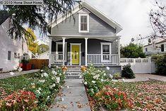 grey house - yellow door