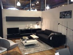 BoConcept Fargo sofa, Schelly chair, functional coffee table, and Volani TV console